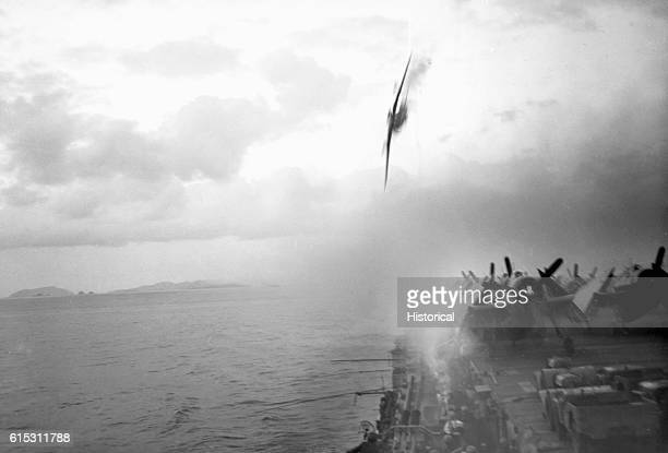 Shots from the USS Sangamon bring down a kamikaze plane that was headed into the ship's deck. The plane fell harmlessly into the sea.