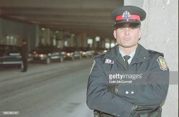 shots of police officer paul mckenna at pearson airport with limos behind him and also with peel police sign