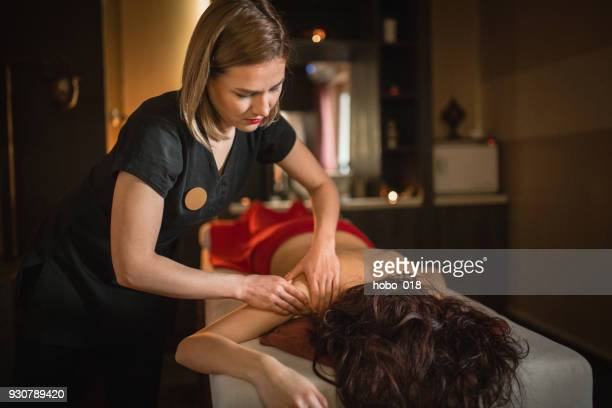 shoulder and hand massage - massage therapist stock pictures, royalty-free photos & images