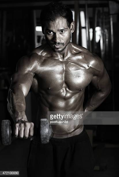 shoulder exercise using dumbbells - asian six pack stock photos and pictures