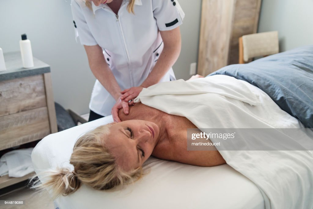 Shoulder massage to mature woman in beauty spa. : Stock Photo