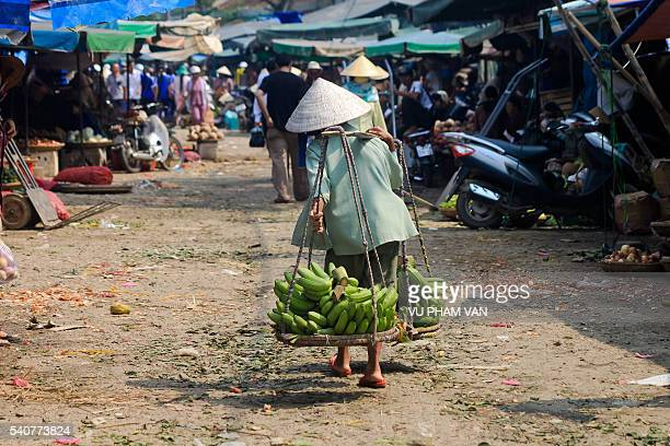 Shoulder pole in Vietnamese daily life