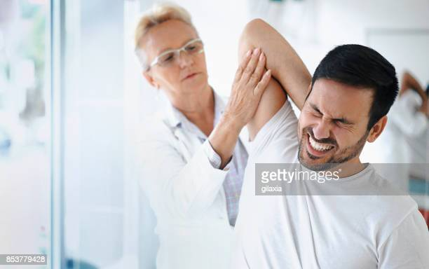 shoulder problems. - personal injury stock photos and pictures