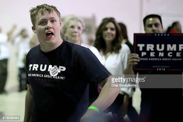 Shouting 'kill yourselves' and 'CNN lies' supporters of Republican presidential nominee Donald Trump jeer members of the news media at the conclusion...