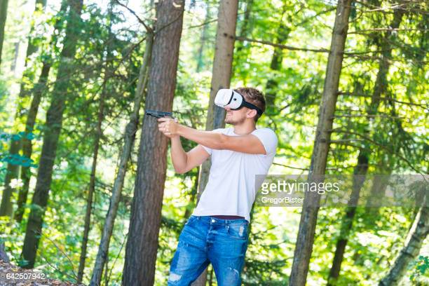 Shouting man in virtual reality headset playing video game