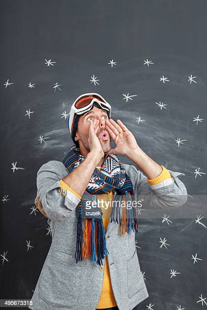 shouting man in winter outfit against blackboard - whistle blackboard stock pictures, royalty-free photos & images