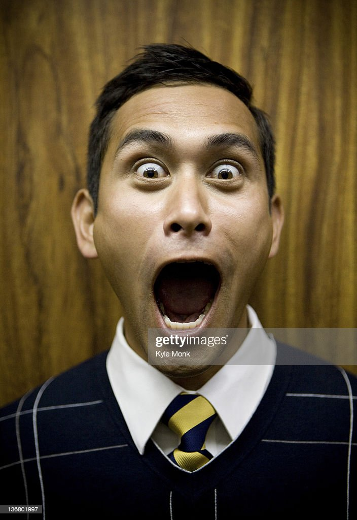 Shouting mixed race businessman : Stock Photo