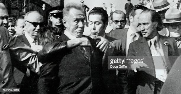 Shouting 'Vive Free Hungary' leatherjacketed 27yearold Geza Matrai of Toronto leaps on back of Soviet Premier Alexei Kosygin as he walks with Prime...