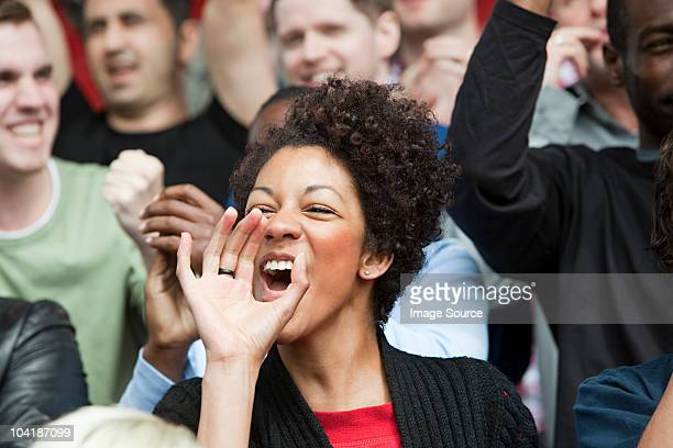 shouting woman at football match - encouragement stock pictures, royalty-free photos & images