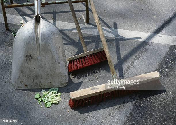 Shovel and brooms outside.