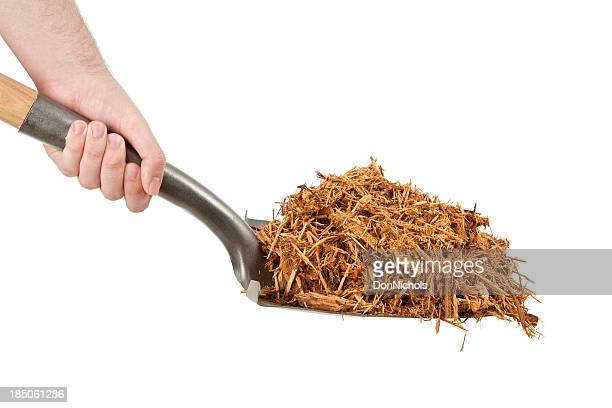 shovel full of cypress mulch - mulch stock pictures, royalty-free photos & images