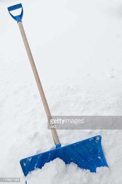 shovel in snow - snow shovel stock photos and pictures
