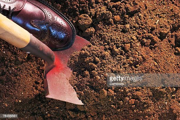 Shovel turning soil for groundbreaking