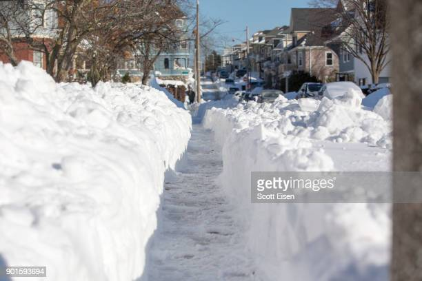 A shoveled sidewalk is seen the day after the region was hit with a 'bomb cyclone' on January 5 2018 in the Dorchester neighborhood of Boston...