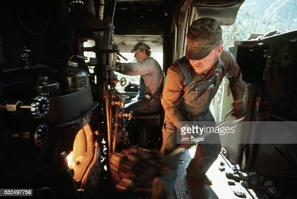 Shoveling Coal into Railroad Engine
