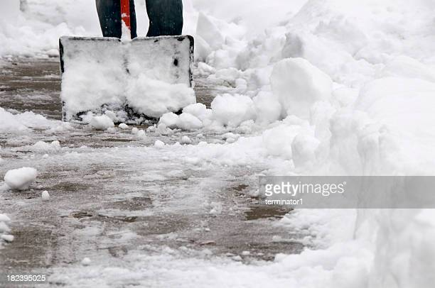 shoveling snow from sidewalk - snow shovel stock photos and pictures