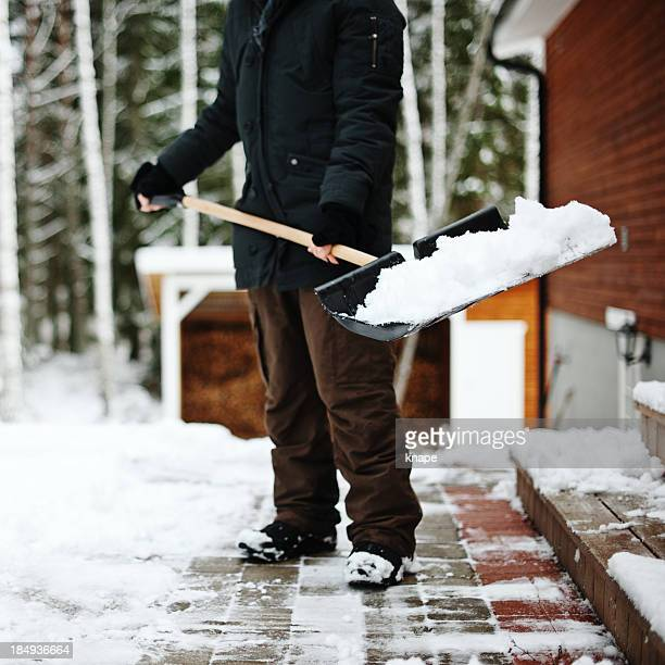 shoveling snow - snow shovel stock photos and pictures