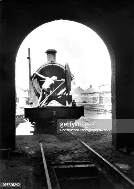 Shovelling hot ashes from the smoke box of a former a LNER Q6 080 at West Hartlepool depot in the mid 1960s