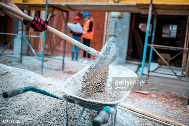 shovelling on construction site - built structure stock pictures, royalty-free photos & images