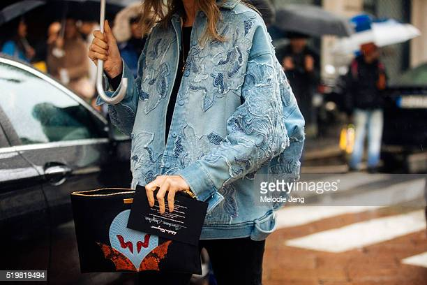 A show attendee wears a floral embroidered denim jacket outside the Ferragamo show at Piazza Affari during the Milan Fashion Week Fall/Winter 2016/17...
