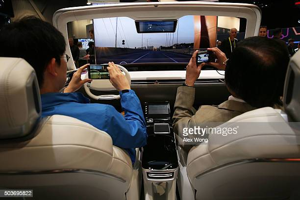 Show attendees experience autonomous driving mode in the Hyundai MOBIS 'iCockpit Car' an experiential simulator of future car driving at CES 2016 at...