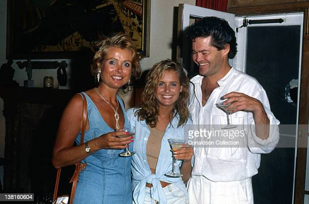 Show business family Samantha Juste Dolenz Micky Dolenz and their daughter Ami Dolenz lift a glass in good spirits as they pose in 1987 in Los...