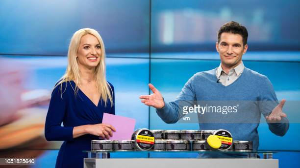 tv show co-hosts presenting premium wax product on tv - television show stock pictures, royalty-free photos & images