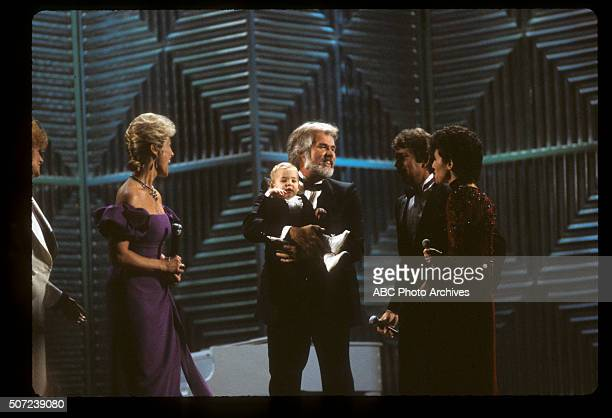 January 17 1983 KENNY ROGERS FAVORITE COUNTRY MALE ARTIST WIFE MARIANNE GORDON AND THEIR SON CHRISTOPHER ROGERS WITH DOTTIE WEST MAC