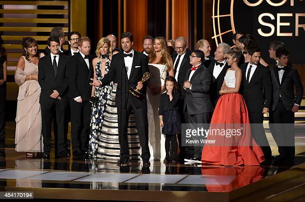 Show creator Steven Levitan with cast and crew accept Outstanding Comedy Series for 'Modern Family' onstage at the 66th Annual Primetime Emmy Awards...