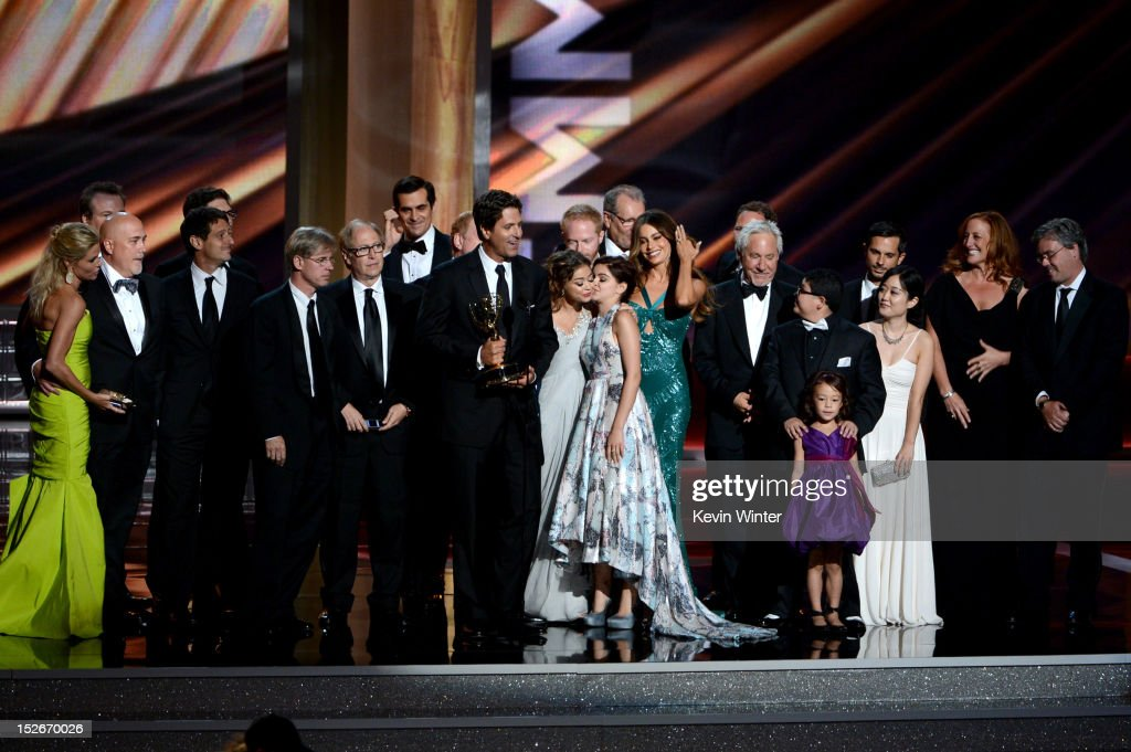 Show creator Steven Levitan (C) with cast and crew members accept the Outstanding Comedy Series Award for 'Modern Family' onstage during the 64th Annual Primetime Emmy Awards at Nokia Theatre L.A. Live on September 23, 2012 in Los Angeles, California.