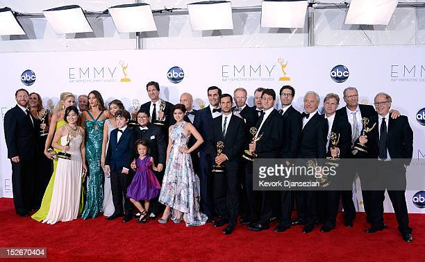 Show creator Steven Levitan with cast and crew members winners of the Outstanding Comedy Series Award for 'Modern Family' pose in the press room...