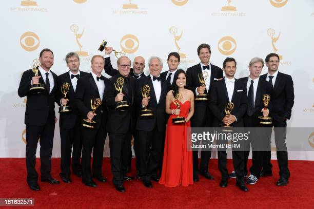Show Creator Steven Levitan with producers winners of Outstanding Comedy Series for Modern Family pose in the press room during the 65th Annual...