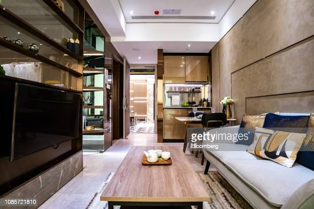 A show flat for the Downtown 38 residential project developed by Sun Hung Kai Properties Ltd is displayed at a showroom for the development in Hong...