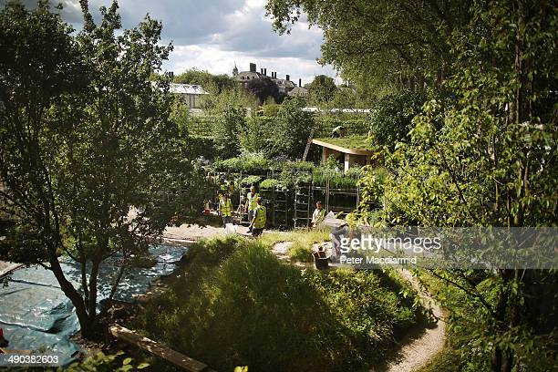 Show gardens are prepared at the Royal Horticultural Society's Chelsea Flower Show on May 14 2014 in London England The prestigious gardening show...