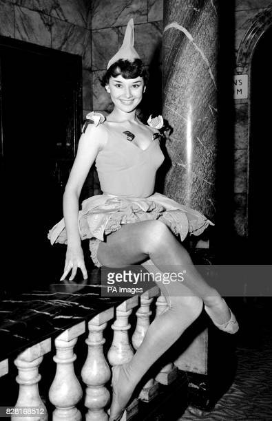 Show girl with a costume appropriate to the season is young Audrey Hepburn, dressed as a tulip in costume designed by Honoria Plesch at the preview...