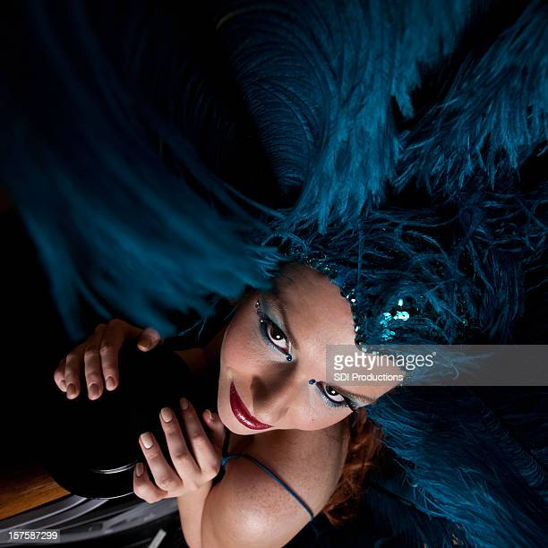 Show Girl With Blue Headdress on Stairwell