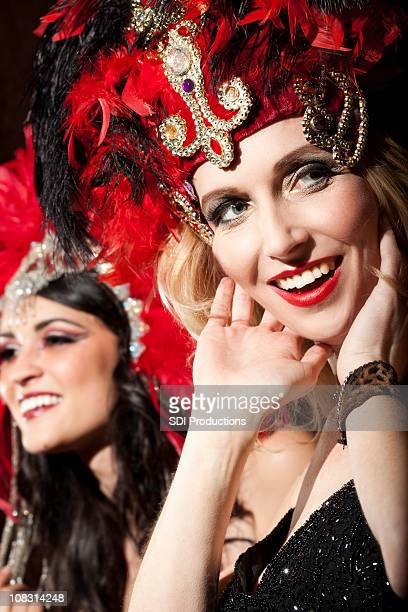 Show Girl with Hands to Her Face Looking at Crowd