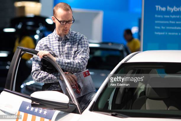Show guest steps inside a 2019 Honda Civic at the Washington Auto Show at the Walter E. Washington Convention Center on April 5, 2019 in Washington,...