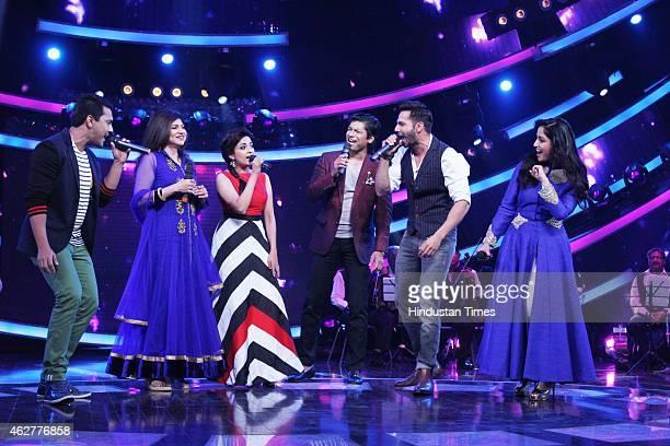 Show host Aditya Narayan singers Alka Yagnik Monali Thakur Shaan with actors Varun Dhawan and Yami Gautam on the sets of Zee TV Reality Show Sa Re Ga...