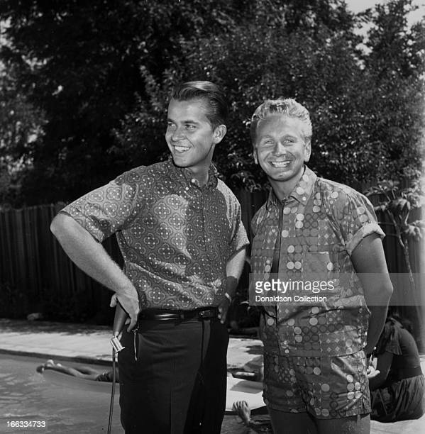 TV show host Dick Clark and actor Kenny Miller at a pool party at Dick Clark's house in 1965 in Los Angeles California