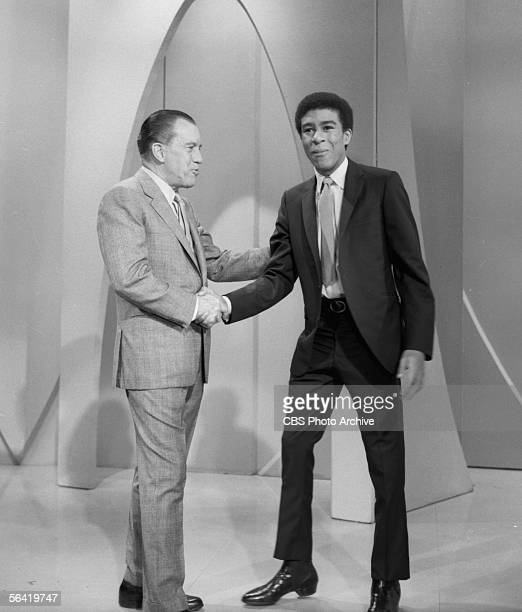 Show host Ed Sullivan shakes hands with guest Richard Pryor. Image dated June 5, 1966.