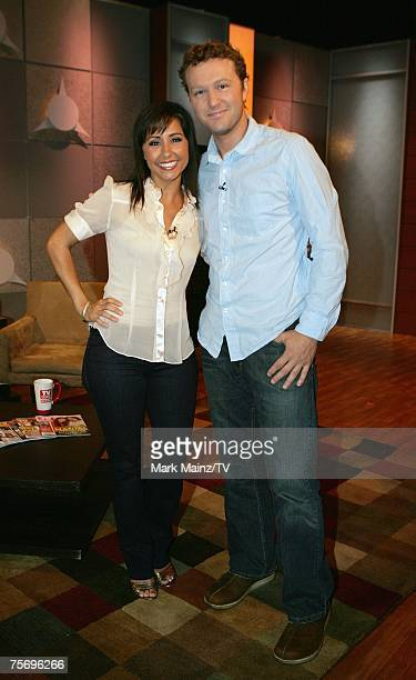 Show host Nikki Boyer and actor Devon Gummersall pose on the set at the Television Guide Channel Studios on July 18 2007 in Hollywood California