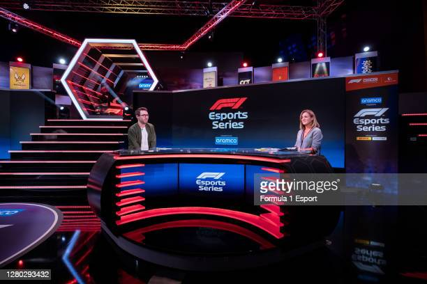Show host Tom Deacon chats with co host Natalie Pickham during round 1 of the F1 Esports Pro Series at GFinity Arena on October 14, 2020 in Fulham,...