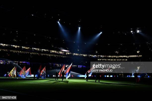 TOPSHOT A show is performed before the French L1 football match Olympique Lyonnais vs Toulouse FC on April 1 at the Parc Olympique Lyonnais stadium...