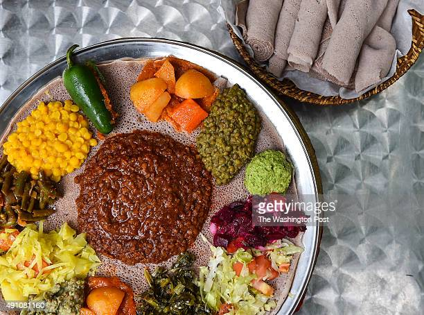 Show is the Veggie Combination Special red lentils brown lentils minced jalapeños beets salad collard greens potatoes and carrots azifa cabbage with...