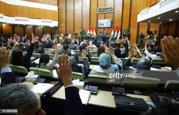 A show of hands takes place during the first session of the Iraqi Kurdish parliament in the northern Kurdish capital of Arbil 350 kms from Baghdad on...