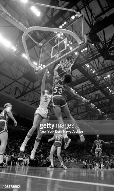 ABA Show Opens at Coliseum Billy Paultz of the Nets pits his 6'11'' frame against 7'2'' Artis Gilmore as they rise toward the ceiling of the Nassau...
