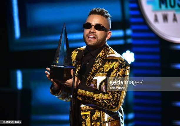 AWARDS Show Pictured Nacho accepts the Cancion Favorita Tropical award at the Dolby Theatre in Hollywood CA on October 25 2018