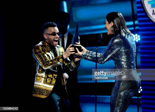 AWARDS Show Pictured Nacho accepts the Cancion Favorita Tropical award from Gaby Espino at the Dolby Theater in Hollywood CA on October 25 2018