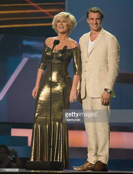 Presenters Christian Bach and Juan Soler on stage during the 2013 Premios Tu Mundo from the American Airlines Arena in Miami Florida August 15 2013...